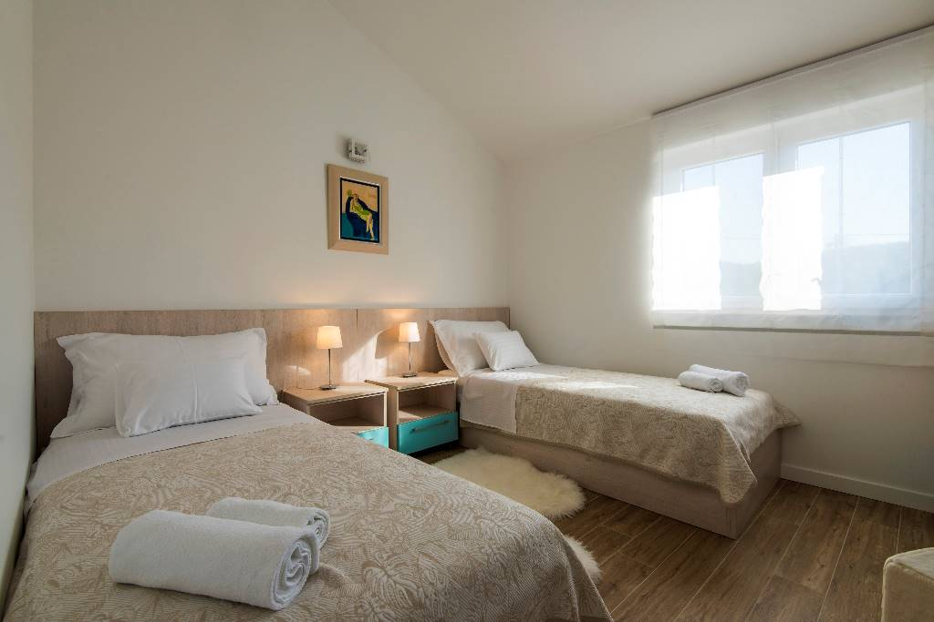 Room 1- twin beds option (satellite TV, air condition, floor heating)
